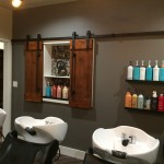 Shampoo Lounge with Barn Door Over Towels